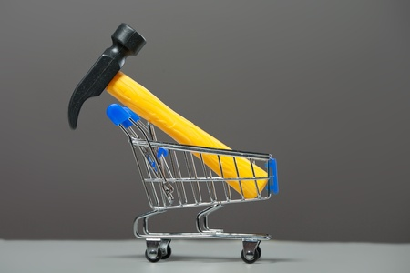 Shopping carts with a hammer. Stock Photo - 10299564