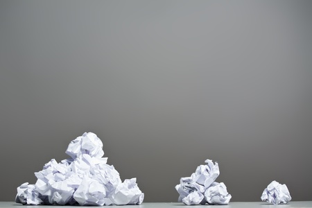 scrunch: Crumpled paper on a gray background. Stock Photo