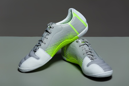 Sport shoes on gray background. photo