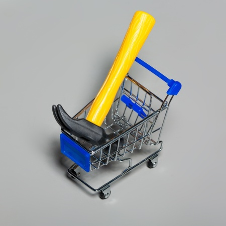 Shopping carts with a hammer. photo