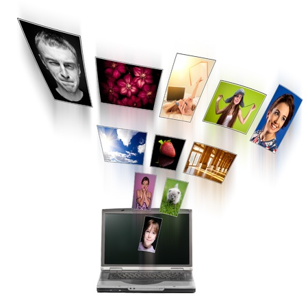 A laptop and digital pictures flying. Stock Photo - 10462674