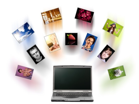 motion picture: A laptop and digital pictures flying.