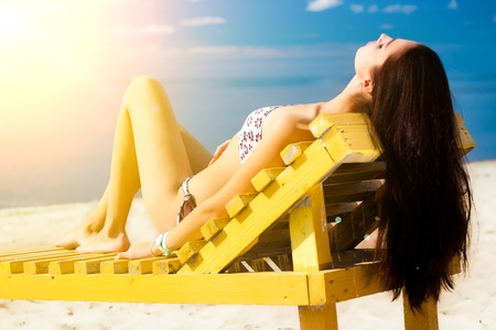 Young woman relaxing on beach  Stock Photo - 10541599