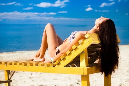Young woman relaxing on beach Stock Photo - 10541617