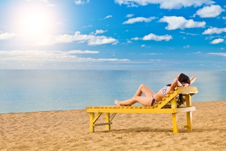 Young woman relaxing on beach  photo