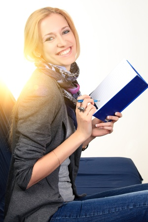Woman with notebook. close up Stock Photo - 10731650