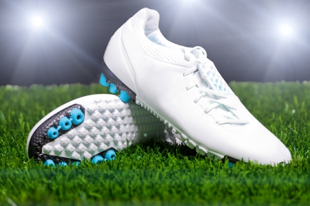 soccer cleats: Football boots on the grass