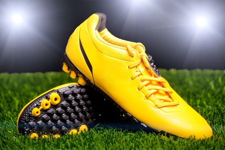 Football boots on the grass photo