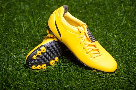 Pair of soccer shoes on grass field photo