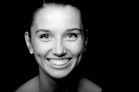 woman portrait on black background photo