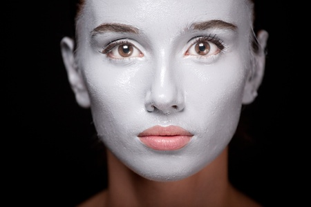 Vogue style portrait of a woman with white makeup photo