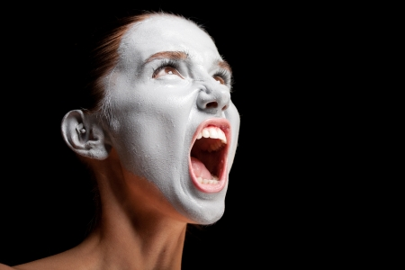 Mime girl looks up and screams. Stock Photo - 10829662