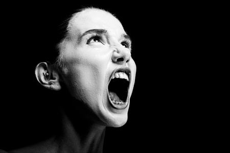 Mime girl looks up and screams. 免版税图像