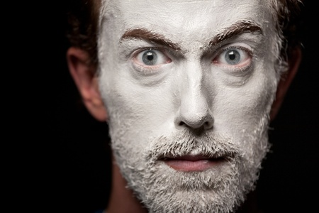 A man with makeup on his face  photo