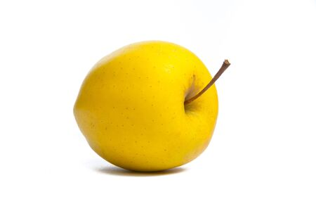 Yellow apple. Studio shot. photo