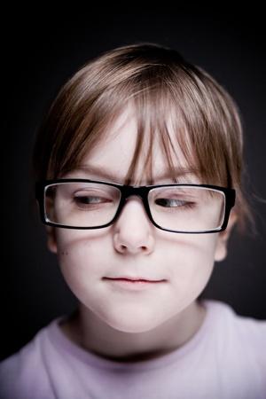 Portrait of a child on a black background. photo