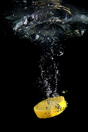 Lemon under water photo