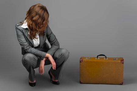 bussines people: A businesswoman with a bag and a suitcase.
