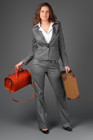 A businesswoman with a bag and a suitcase. Stock Photo - 11230752
