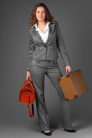A businesswoman with a bag and a suitcase. Stock Photo - 11230820