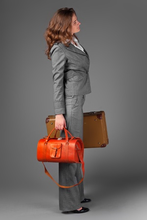 A businesswoman with a bag and a suitcase. Stock Photo - 11230767