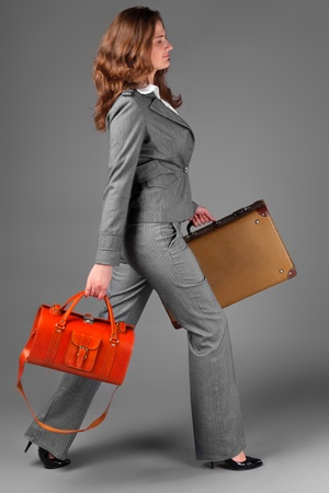 A businesswoman with a bag and a suitcase. Stock Photo - 11230788