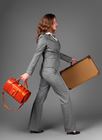 A businesswoman with a bag and a suitcase. Stock Photo - 11230791