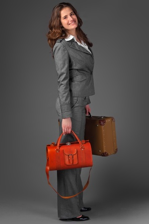 A businesswoman with a bag and a suitcase. Stock Photo - 11230748
