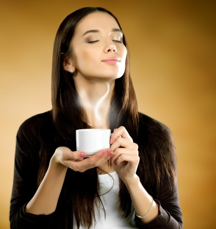 Woman with coffee cup photo