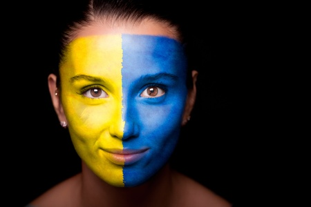 Portrait of a woman with the flag of the Ukraine photo