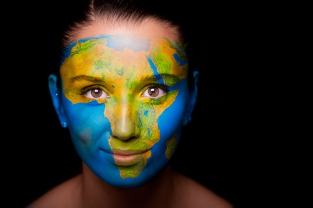 Girl with a painted map of Africa on his face.
