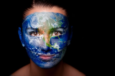 Girl with a painted map of World on his face. photo