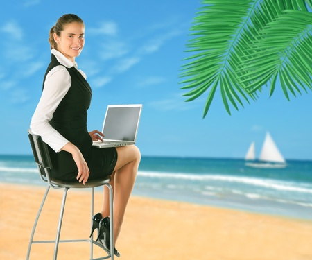 Businesswoman on the beach.  photo