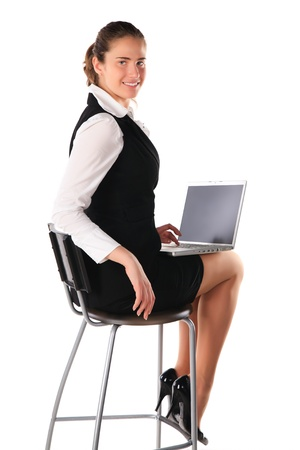 Business woman works on the laptop photo