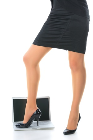 Womens legs and the laptop. photo