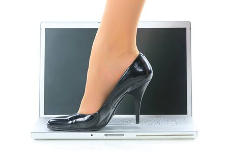 Women's legs and the laptop. photo