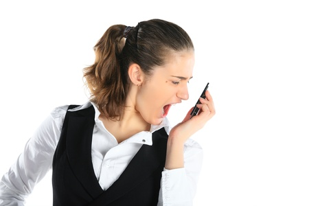 A woman shouting at a mobile phone Stock Photo - 11889413