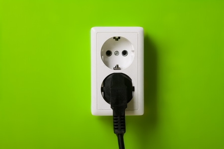 White electric socket on the wall. photo