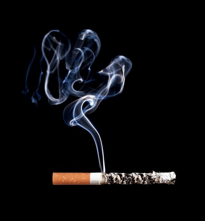 Smoking cigarette. Isolated on black. Stock Photo - 11889488