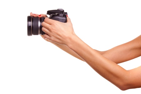 Womens hands holding the camera. photo
