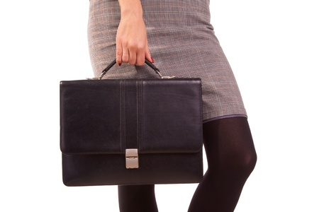 Woman and a black leather briefcase. photo