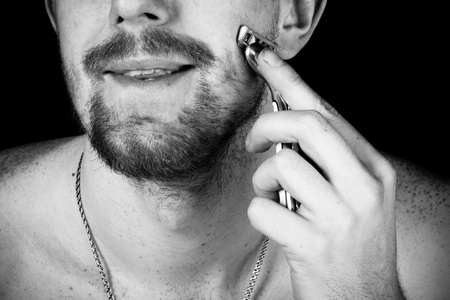 Men shaving faces. Close-up. photo