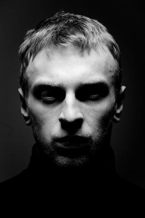 alone in the dark: Portrait of a Man.