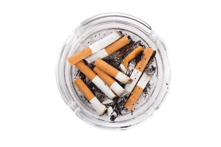 Ashtray full of cigarettes close-up photo