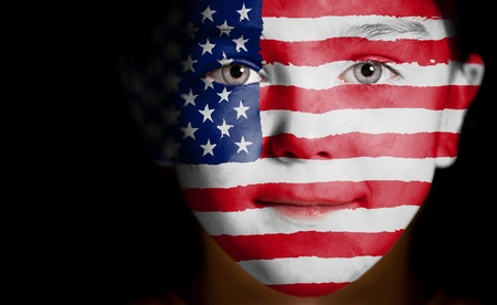 usa patriotic: Child face painted with the flag of USA.