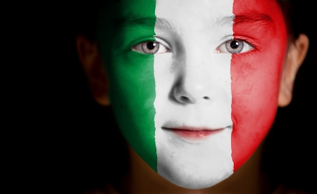 italian PEOPLE: Child face painted with the flag of Italy.