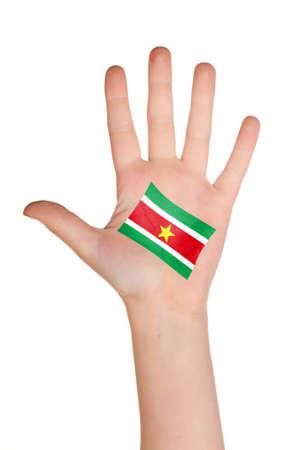 La bandera de Surinam, pintado en la palma de la mano. Foto de archivo - 12407106