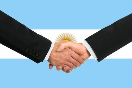 The Argentine flag and business handshake Stock Photo - 15411000