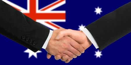 The Australian flag and business handshake photo