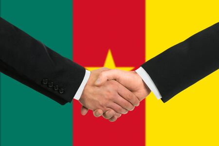 cameroonian: The Cameroonian flag and business handshake